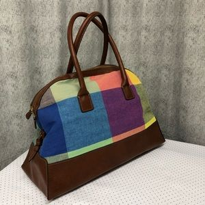Brown leather and canvas duffle bag.